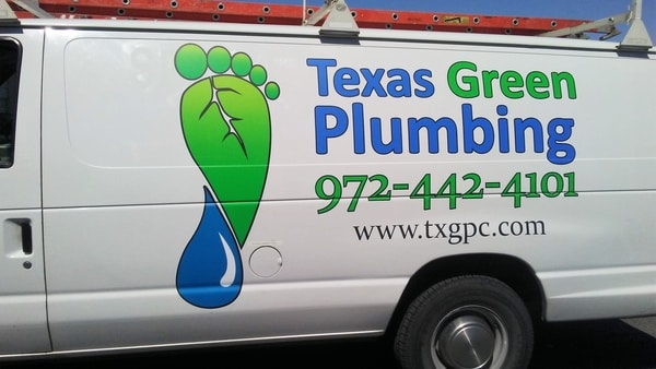 White work truck with green and blue decals for plumbing company