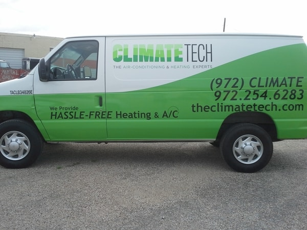 Green and white work van with car wrap vinyl decals for ac company