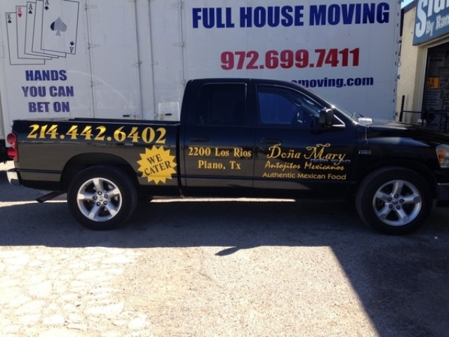 Black work truck with yellow decals for Mexican food restaurant