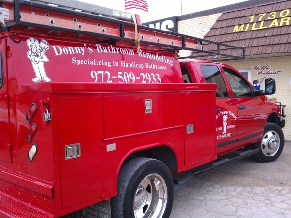 Red work truck with white decals for remodeling company