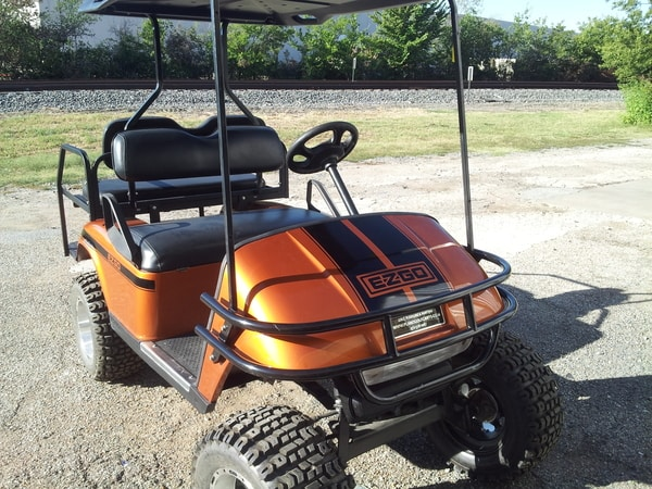 Orange golf cart with black vinyl decals