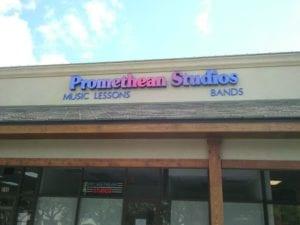Storefront sign for Promethean Studios