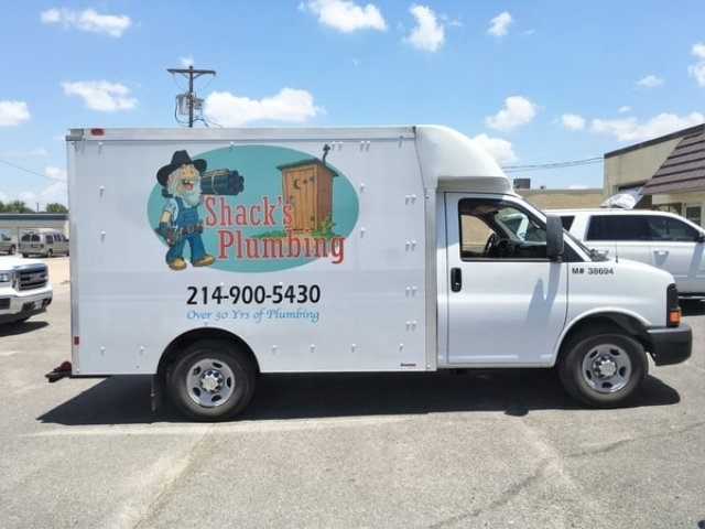 White moving truck with vinyl decals for plumbing company