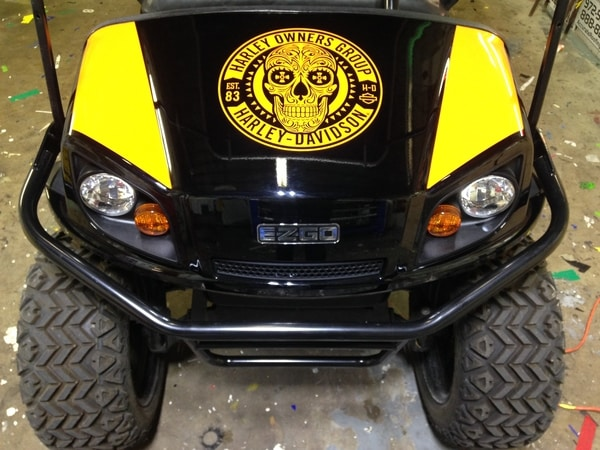 Black and yellow golf cart with Harley-Davidson Group skull decal