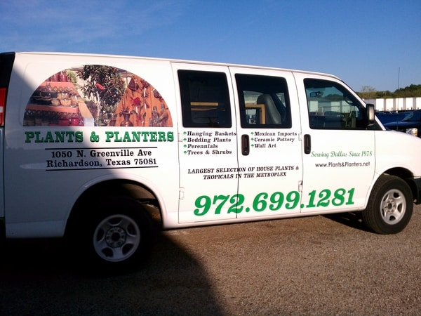 White van with vinyl decals for a plant and landscaping company