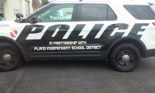 White SUV with decals for the Plano ISD Police