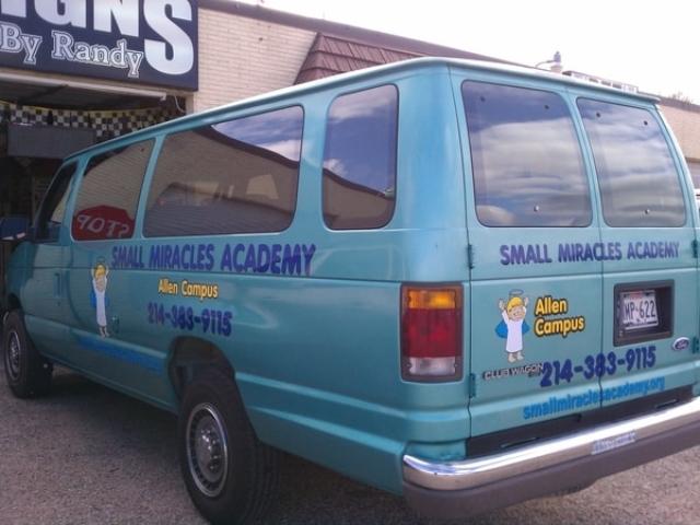 Blue transport van with vinyl decals for a children's academy