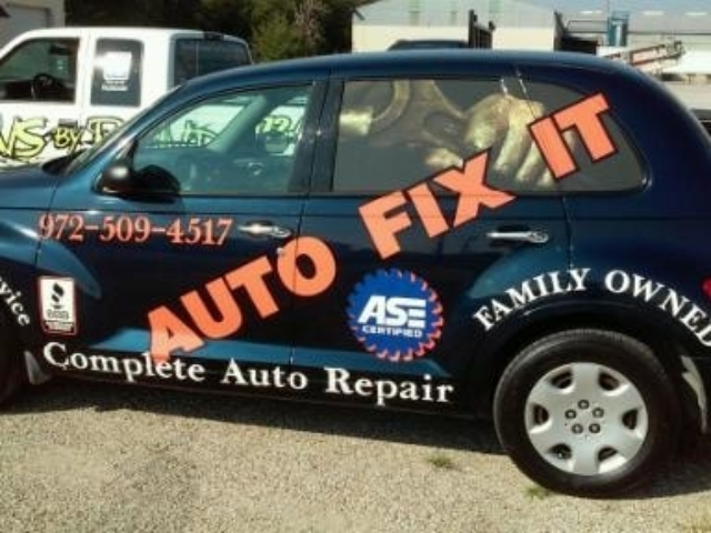 Dark colored SUV with decals for auto repair company