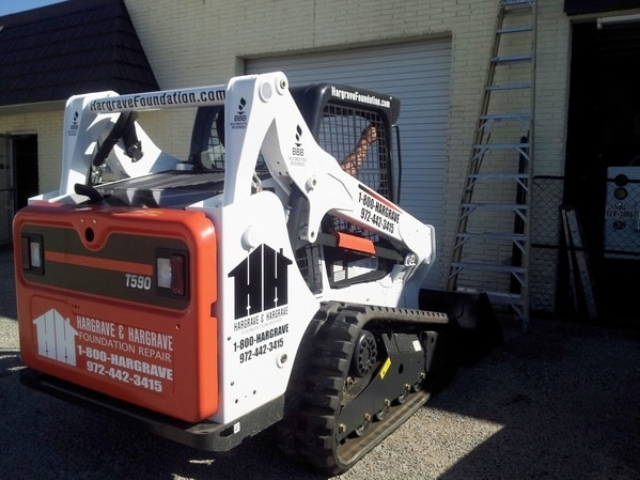 Foundation repair machinery with vinyl decals