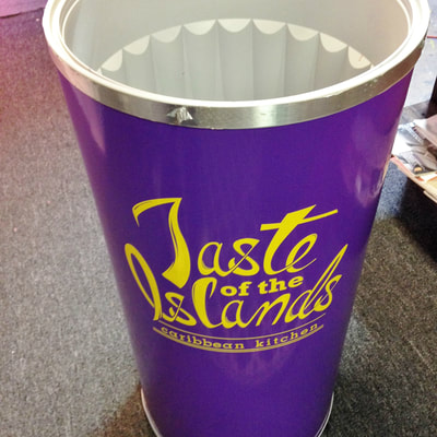Tall beverage cooler with decals for Caribbean restaurant