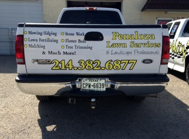 White F350 truckbed with yellow vinyl lettering for law service company