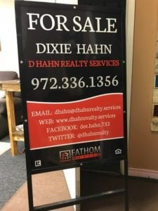 A for sale sign for D Hahn Realty Services